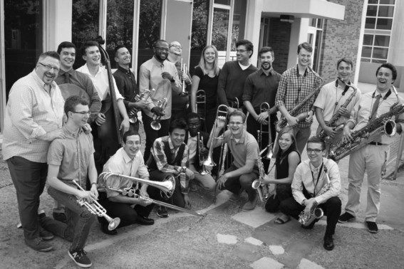 Black and white group photo of Marko Marcinko and his students smiling and holding instruments.