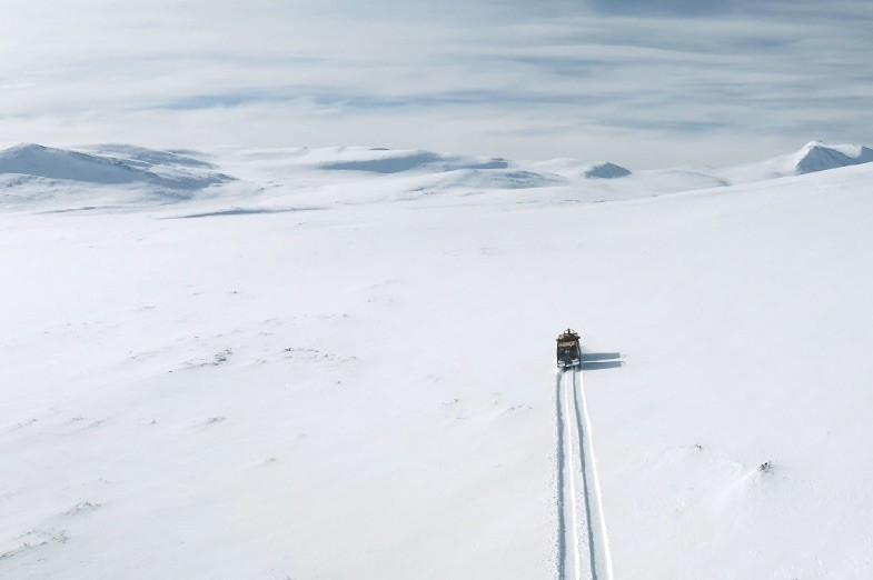 Film still of truck crossing a barren, snowy landscape from the documentary Landscape Healing, directed by Richard John Seymour and produced by 3RW arkitekter in 2019.