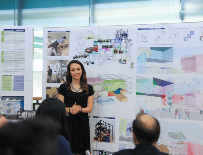 A fifth-year architecture student presents her thesis to a jury.
