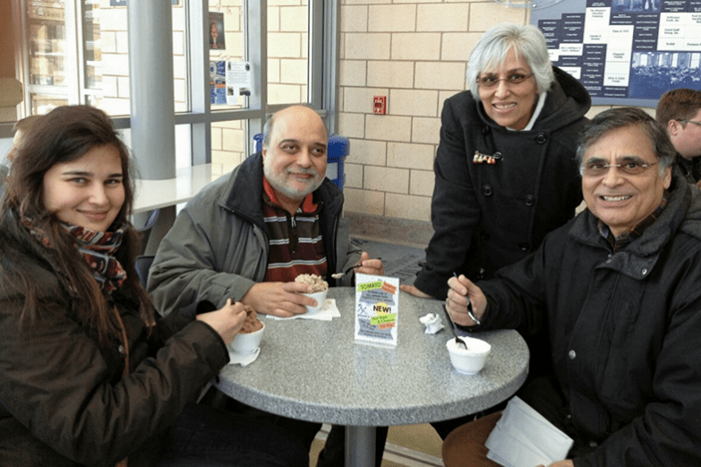 Jawaid Haider with a student's family at the Creamery.