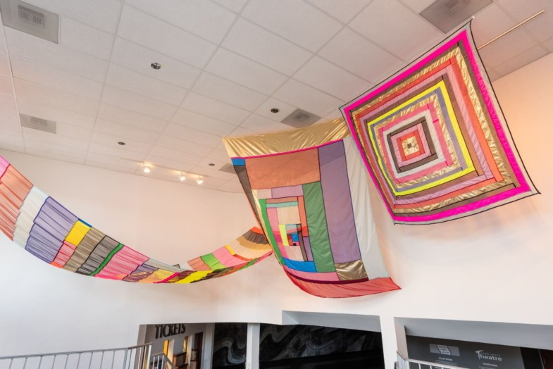Colorful fabric panels suspended from the ceiling.