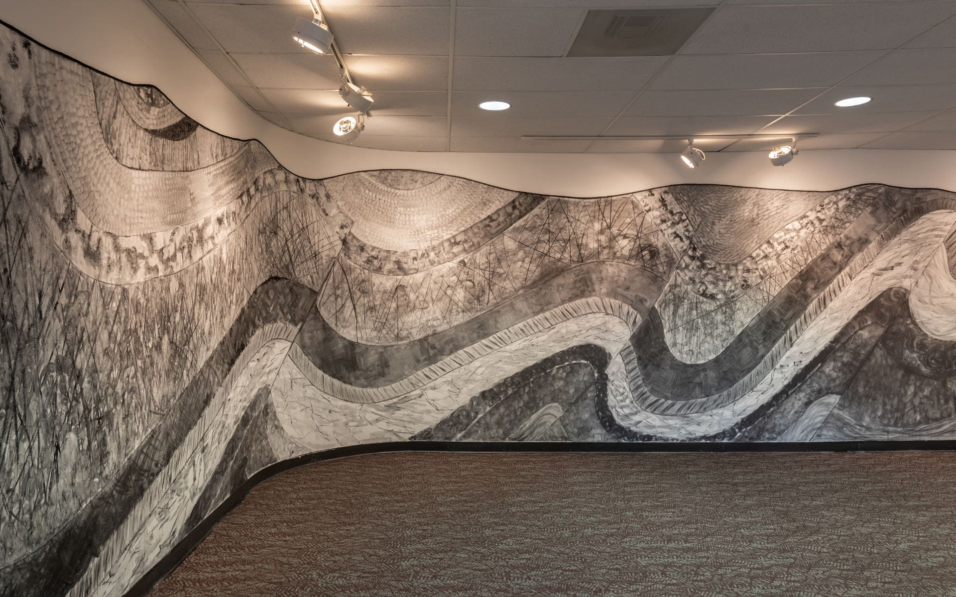 Panoramic charcoal illustration of central Pennsylvania's landscape on a curved wall.